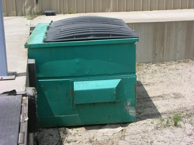Figure 11. Photo of a covered bin for garbage bags containing discarded plant material.