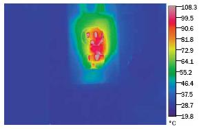 A thermographic (uses colour to indicate hot spots) image of an electrical outlet in a barn.  The outlet is showing signs of temperatures greater than 100°C due to increased electrical resistance caused by corrosion in the fixture.