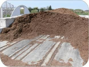 Used conveyor belting from a quarry operation was used as a floor to protect the soil from rutting under this landscape compost pile.