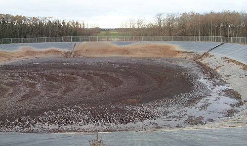This picture shows an in-ground, earthen manure storage facility, built with a synthetic liner to provide the required protection for surface and ground water.