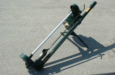 Picture of a vertical pump or electric chopper agitator pump standing on pavement. This pump is used to remove manure from storages under barns and from small transfer or surge storages.