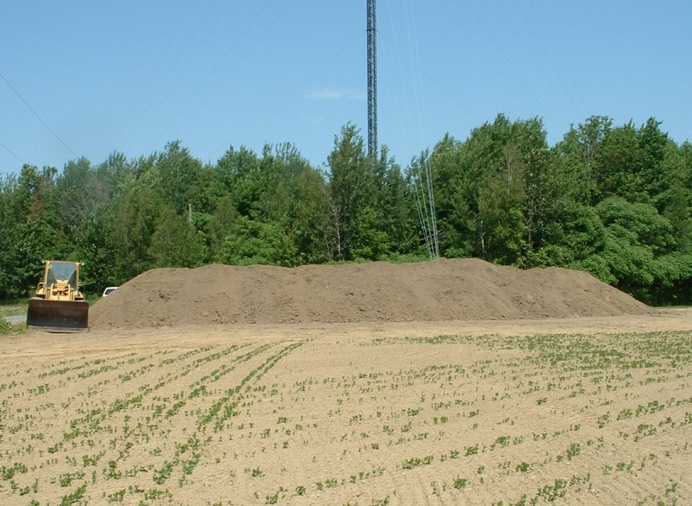 Photo of a temporary field storage for pulp and paper biosolids