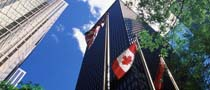 high rise buildings and Canadian flag