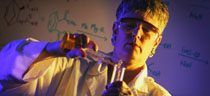 scientist pouring test tubes